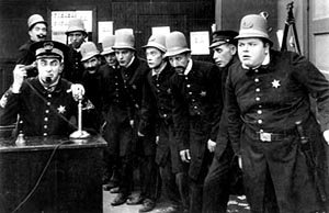 The Keystone Kops. Ford Sterling on phone. Fatty Arbuckle, far right.